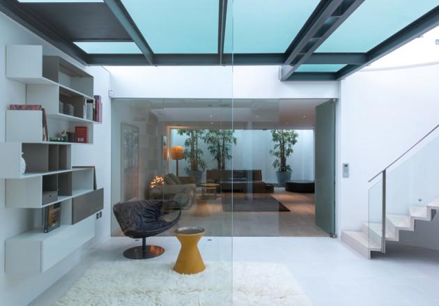 La maison Verre de Tim Poulson. www.clemaroundthecorner.com