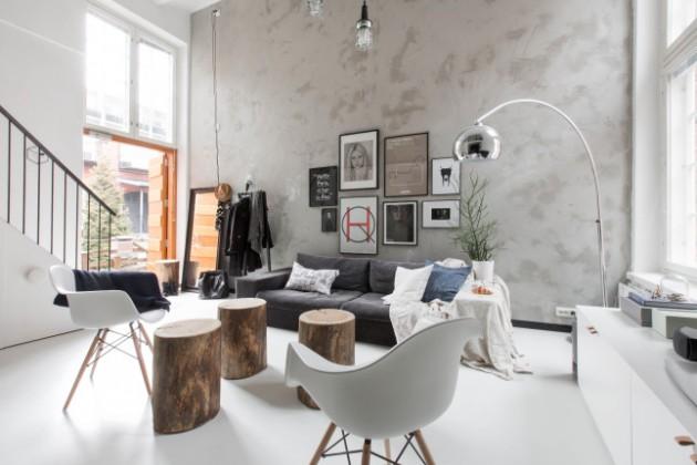 Salon déco intérieur finlandais et matériaux bruts mur en béton ciré.