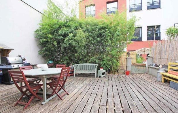 Une maison loft avec terrasse et patio à pantin.