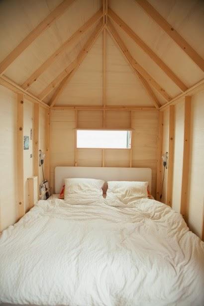 Chambre parentale cabane en bois sous les toits cocon.