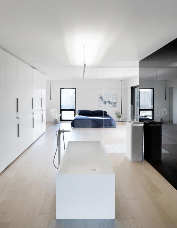suite parentale minimaliste Moshe Safdie Habitat 67 par Studio Practice