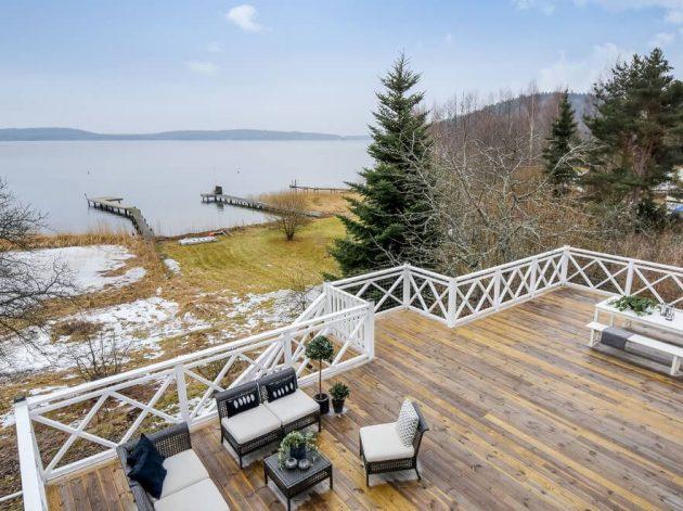 terrasse en bois face au lac suède