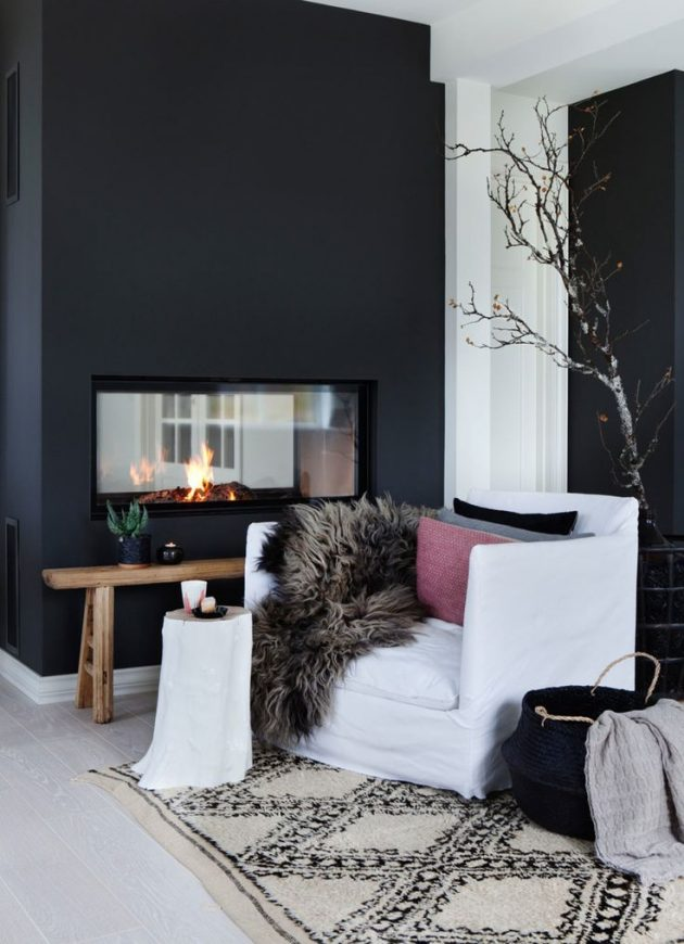 salon scandinave en noir et blanc mur cheminée