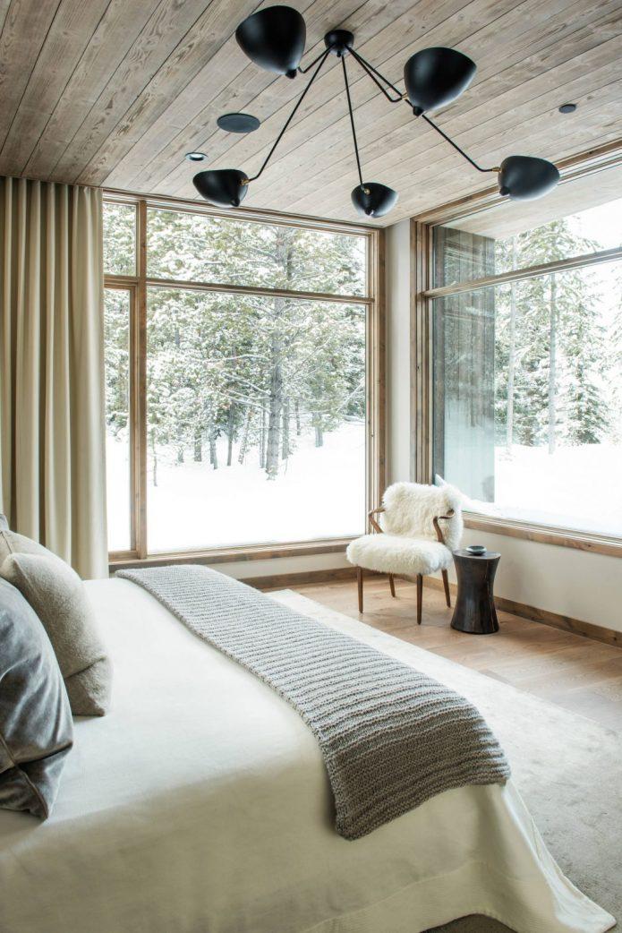 visite deco loft chalet chambre baie vitre foret enneigee