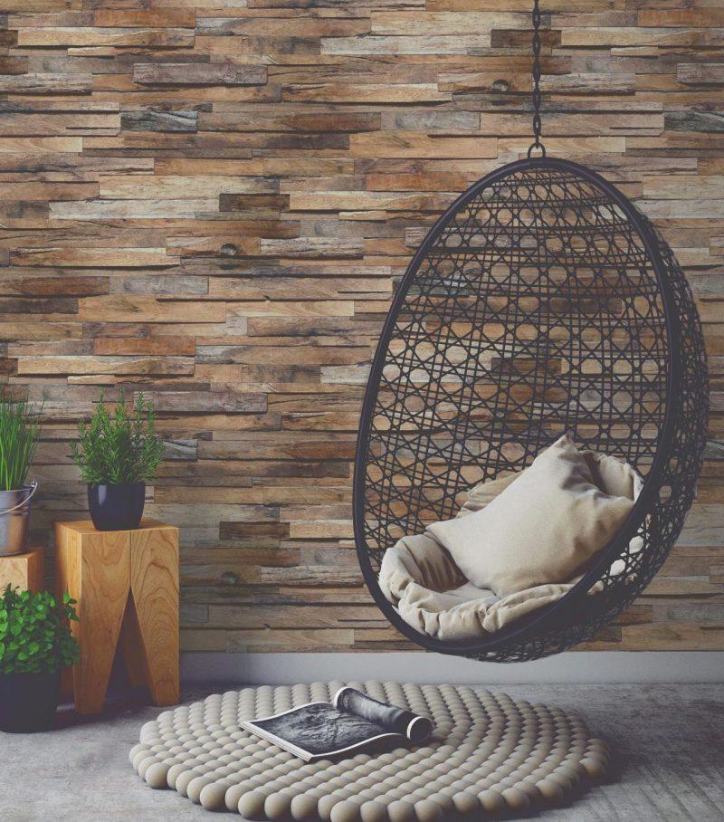mur de bois fauteuil suspendu intérieur tapis boule de laine
