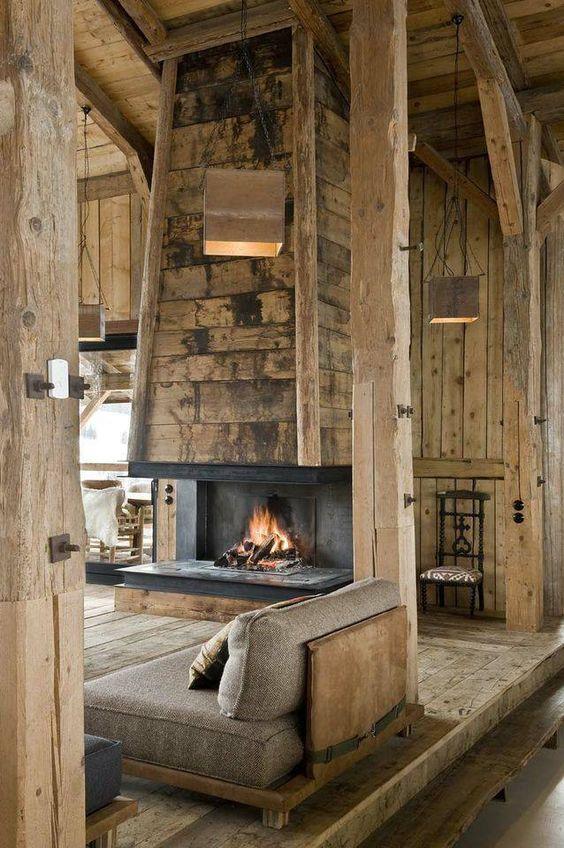 salon chalet cheminee centrale mur de bois lambris vieili decoration blog