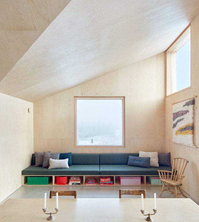 chalet design en norvège salon banquette coussins canapé blog déco clem around the corner