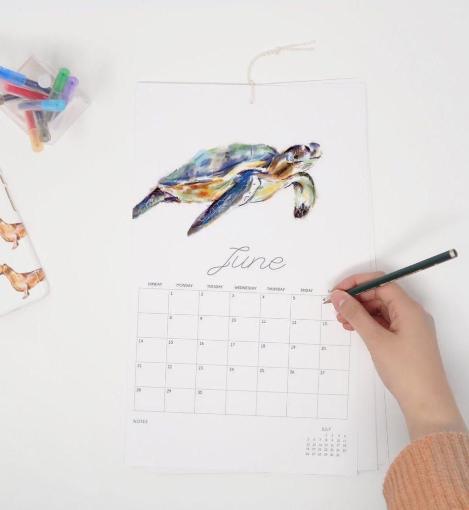 calendrier animaux blanc épuré calligraphie sophistiquée