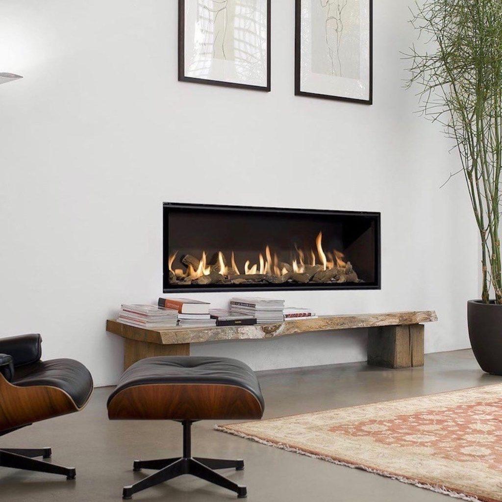 salon design poêle à gaz décoration intérieure fauteuil eames - blog déco - clemaroundthecorner