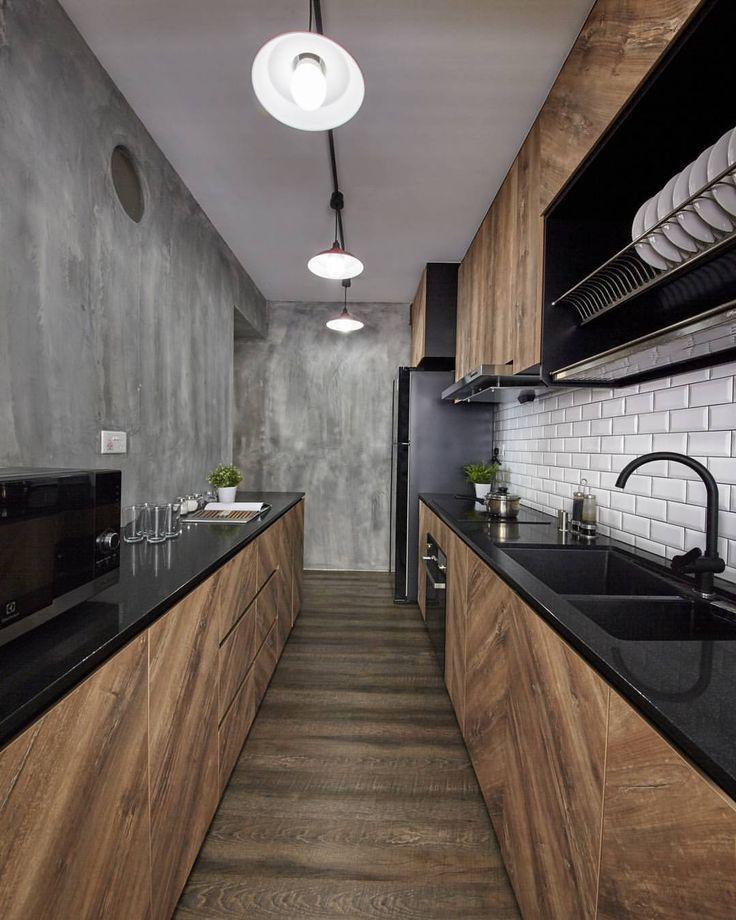 déco industrielle mur béton brut gris bois lamé plan de travail noir satiné