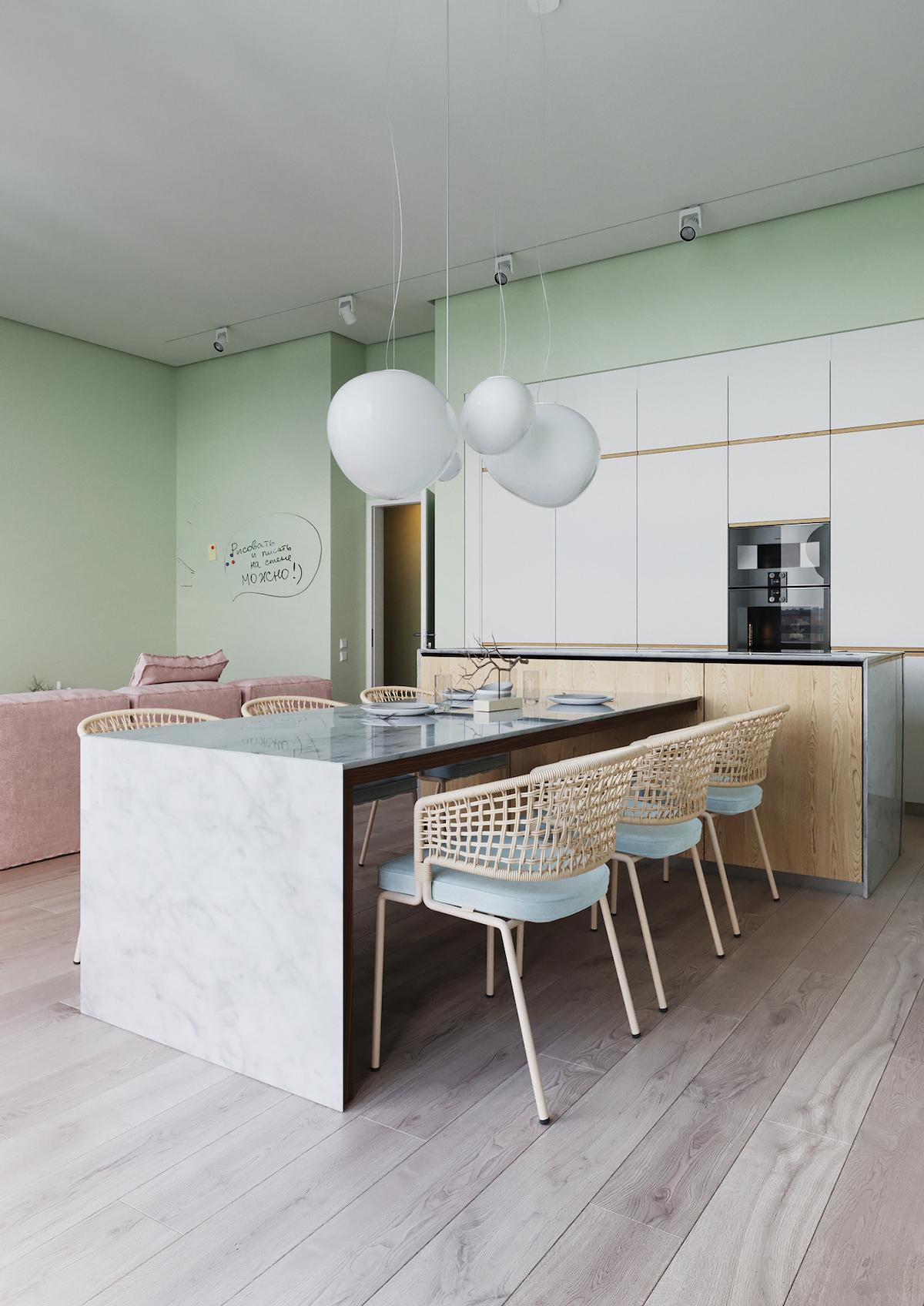 cuisine ouverte ilot centrale bas table de salle à manger plan de travail marbre chaise rotin