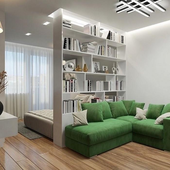 studio lumineux commode blanche cloison canapé vert néon lumineux plafond