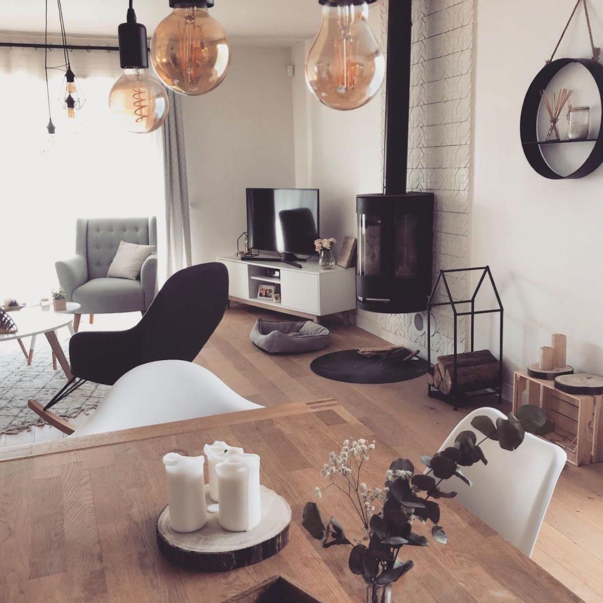séjour fauteuil à bascule noir poêle cheminée - blog déco - clematc