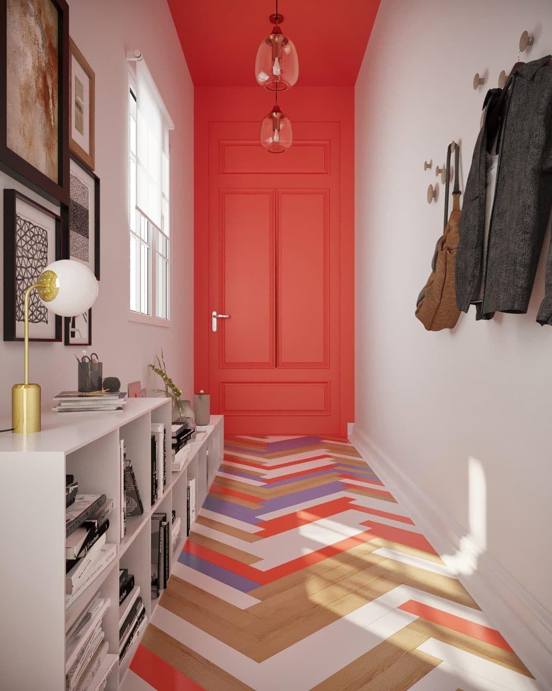 hall d'entrée lumineuse colorée rouge corail sol chevron multicolor lampe ronde laiton