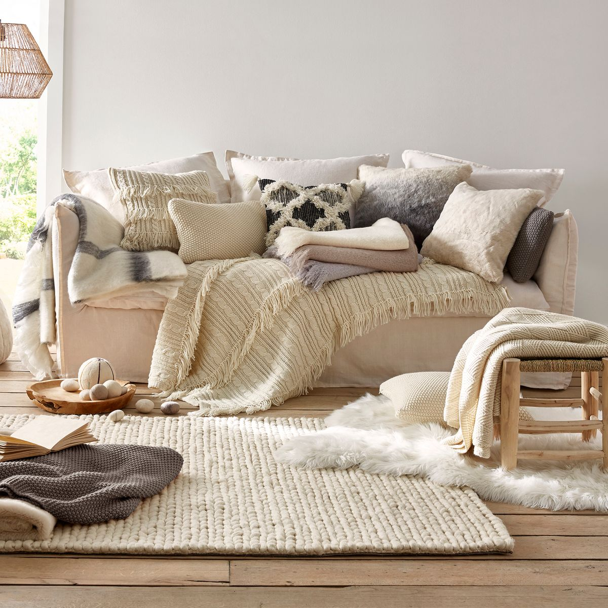 canapé lin multitude plein coussins coton laine mélange salon tendance hiver cocooning design