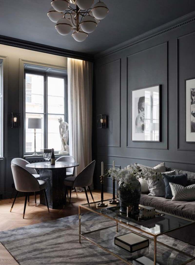 blog déco clematc salon noir luxueux moderne table verre laiton moulures murs