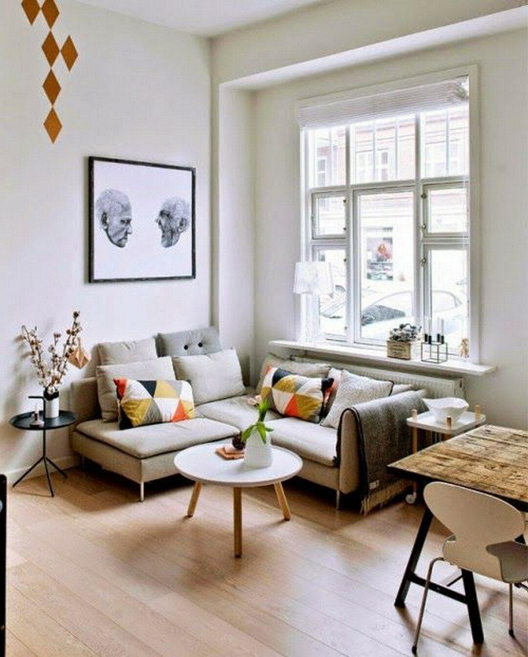 petit salon canapé d'angle gris beige table basse ronde coussin vintage rouge orange blog deco