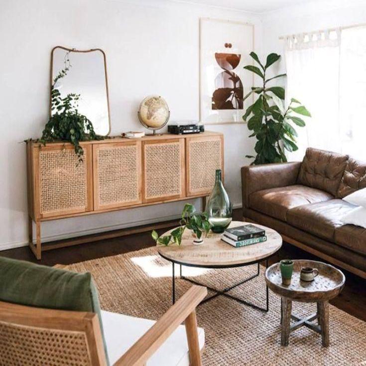 salon cannage tapis fibre naturelle table basse ronde bois canapé cuir marron